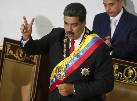 Venezuela's President Nicolas Maduro gestures to members of the Constituent Assembly during a ceremony to recognize him as the winner of the presidential election in Caracas, Venezuela, Thursday, May 24, 2018. Maduro was declared with winner of the May 20 presidential election, and will be sworn-in for his second, six-year term on Jan. 10, 2019. (AP Photo/Ariana Cubillos)