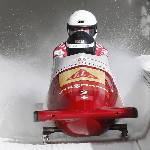 epa04619061 Beat Hefti and Baumann Alex of Switzerland race at 2 Man Bobsleigh competition during FIBT Bobsleigh World Cup 2014/2015 in Sochi, Russia, 14 February 2015.  EPA/SERGEI ILNITSKY