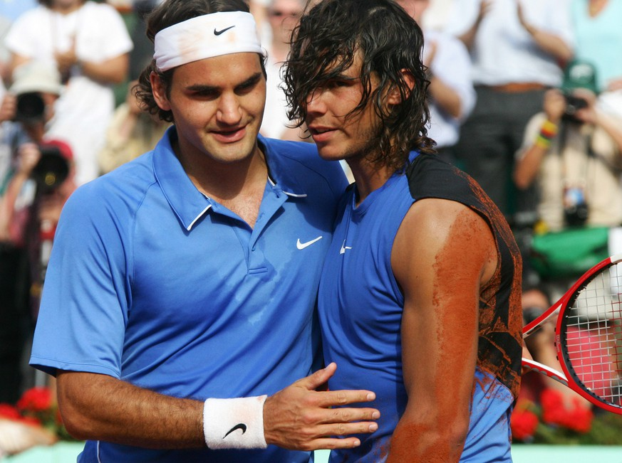 Spain's Rafael Nadal, right, gets a hug from Switzerland's Roger Federer after the men's final match during the French Open tennis tournament at the Roland Garros stadium in Paris, Sunday June 11, 2006. Nadal won 1-6, 6-1, 6-4, 7-6. (AP Photo/Michel Spingler)