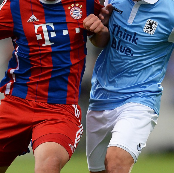 MUNICH, GERMANY - AUGUST 12: Steeven Ribery (L) of Bayern Muenchen and Kasim Rabihic of TSV 1860 Muenchen compete for the ball during the Regionalliga match between TSV 1860 Muenchen II and FC Bayern Muenchen II at Stadion an der Gruenwalder Strasse on August 12, 2014 in Munich, Germany.  (Photo by Micha Will/Bongarts/Getty Images)