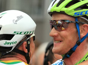 Australia's Simon Gerrans, left, of the Orica Greenedge team is reflected in the sunglasses of team mate Pieter Weening of the Netherlands as he celebrates after winning the 100th edition of the Belgian cycling classic and UCI World Tour race Liege-Bastogne-Liege, in Ans, Belgium, Sunday, April 27, 2014. Spain's Alejandro Valverde of the Movistar team came second, followed by Poland's Michal Kwiatowski of the Omega Pharma Quickstep team who placed third. (AP Photo/Yves Logghe)