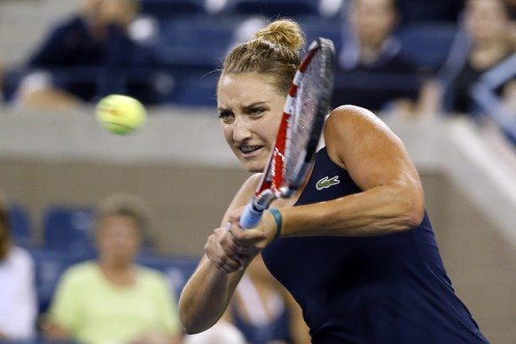 Timea Bacsinszky, of Switzerland, returns a shot to Venus Williams, of the United States, during the second round of the U.S. Open tennis tournament Wednesday, Aug. 27, 2014, in New York. (AP Photo/Jason DeCrow)