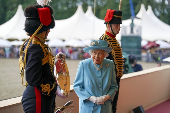 Britain's Queen Elizabeth II presents the trophy for the best gun team, the King's Troop Royal Horse Artillery, at the Royal Windsor Horse Show, Windsor, England, Sunday July 4, 2021. (Steve Parsons/PA via AP)