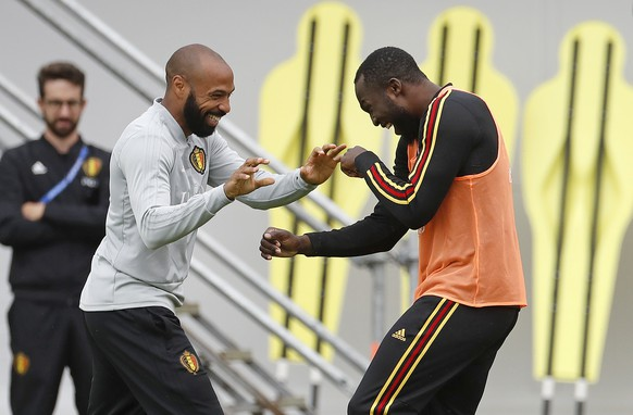 Belgium assistant coach Thierry Henry, left, jokes with Belgium's Romelu Lukaku during a training session on the eve of the semifinal against France at the 2018 soccer World Cup in Moscow, Russia, Monday, July 9, 2018. (AP Photo/Alexander Zemlianichenko)