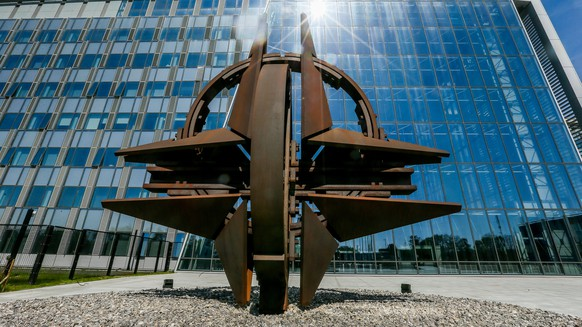 epa06679623 The NATO star sculpture is seen in front of the new NATO (North Atlantic Treaty Organization) headquarters in Brussels, Belgium, 19 April 2018. The final move to the new building is scheduled for mid-June.  EPA/STEPHANIE LECOCQ