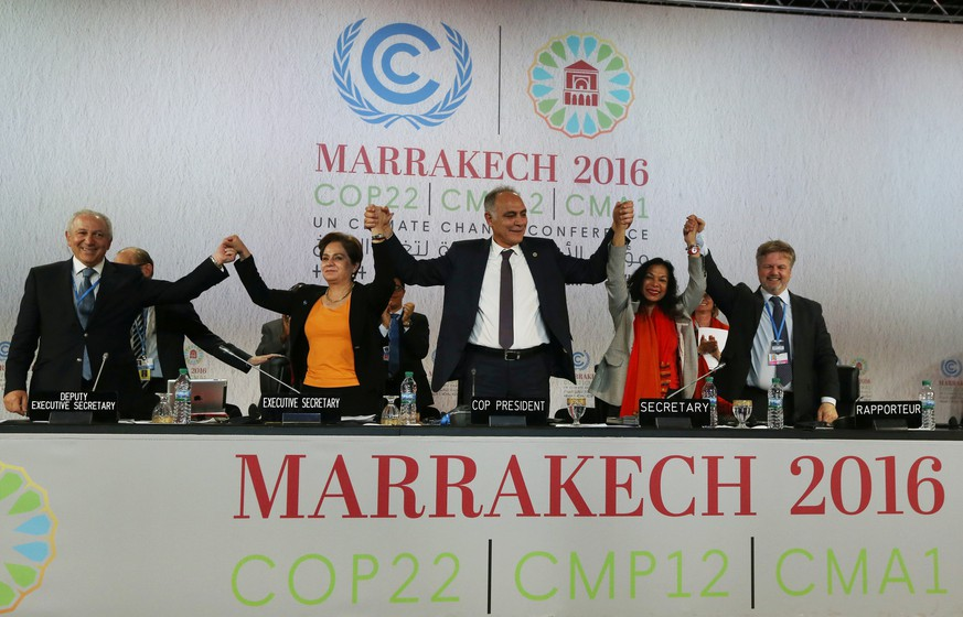 U.N. climate chief Patricia Espinosa (2nd L), Morocco's Foreign Minister Salaheddine Mezouar (C), and Council of Europe Goodwill Ambassador Bianca Jagger (2nd R) celebrate after the proclamation of Marrakech, at the UN World Climate Change Conference 2016 (COP22) in Marrakech, Morocco, November 17, 2016. REUTERS/Stringer   FOR EDITORIAL USE ONLY. NO RESALES. NO ARCHIVES