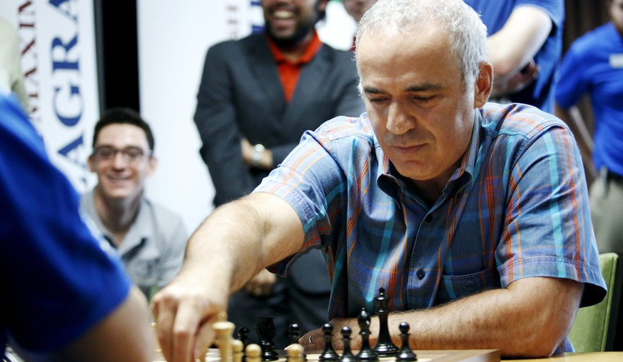 IMAGE DISTRIBUTED FOR INVISION FOR CHESS CLUB AND SCHOLASTICS CENTER OF ST. LOUIS - World chess legend Garry Kasparov makes a move during a series of rapid and blitz exhibition games called Ultimate Moves held following the 2015 Sinquefield Cup at the Chess Club and Scholastics Center of St. Louis on September 3, 2015, in St. Louis. (Photo by Erin Stubblefield/Invision for Chess Club and Scholastics Center of St. Louis/AP Images)