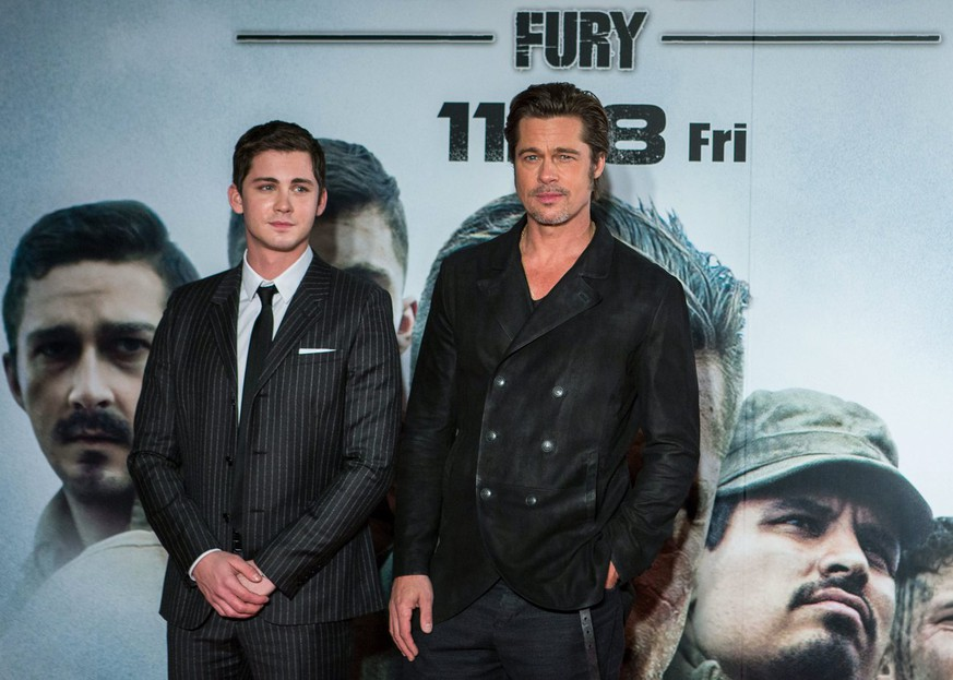 epa04490512 US actors and cast members Logan Lerman (L) and Brad Pitt (R) attend the premiere of 'Fury' in Tokyo, Japan, 15 November 2014. The action drama war movie will be released in movie theaters across Japan on 28 November.  EPA/CHRISTOPHER JUE   EDITORIAL USE ONLY/NO SALES