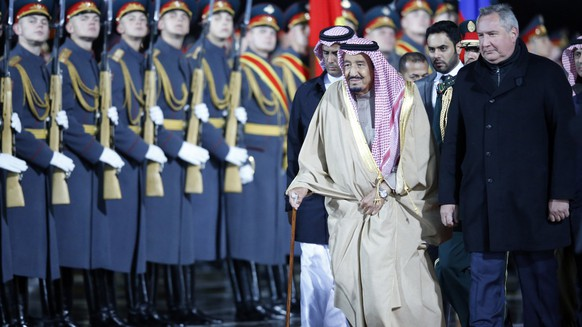 epa06244486 Saudi Arabia's King Salman bin Abdulaziz Al Saud (front L) flanked by Russian Deputy Prime Minister Dmitry Rogozin (front R) reviews the honor guards upon arrival at Vnukovo II airport in Moscow, Russia, 04 October 2017. King Salman bin Abdulaziz Al Saud of Saudi Arabia arrived on a state visit in Moscow.  EPA/SERGEI CHIRIKOV