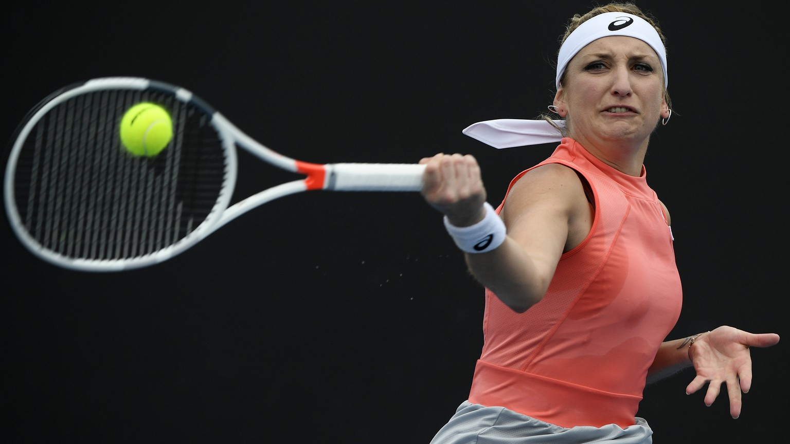 Switzerland's Timea Bacsinszky makes a forehand return to Russia's Daria Kasatkina during their first round match at the Australian Open tennis championships in Melbourne, Australia, Tuesday, Jan. 15, 2019. (AP Photo/Andy Brownbill)