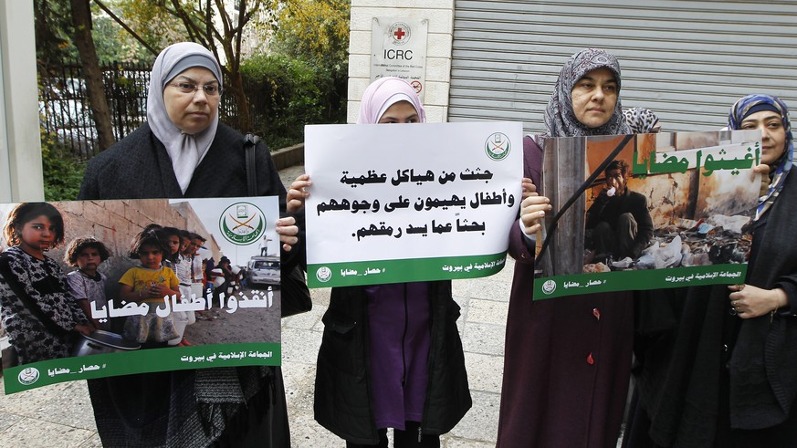 epa05092720 Supporters of Jemaah Islamiyah (Islamic Group) carry placards depicting pictures believed to be for children from the Syrian town of Madaya and Arabic reading 'Save children of Madaya' during a protest in front of the International Committee of the Red Cross (ICRC) headquarters in Beirut, Lebanon, 08 January 2016. Aid agencies have received permission from the Syrian government to deliver relief supplies to the three besieged towns, Madaya, Foua and Kefraya, whose residents are reportedly starving, the Red Cross said. Madaya, a rebel-held town about 25 kilometres north-west of the capital, Damascus, has been under siege since July by forces loyal to Syrian President Bashar al-Assad, aided by fighters from the allied Lebanese Hezbollah movement.  EPA/NABIL MOUNZER