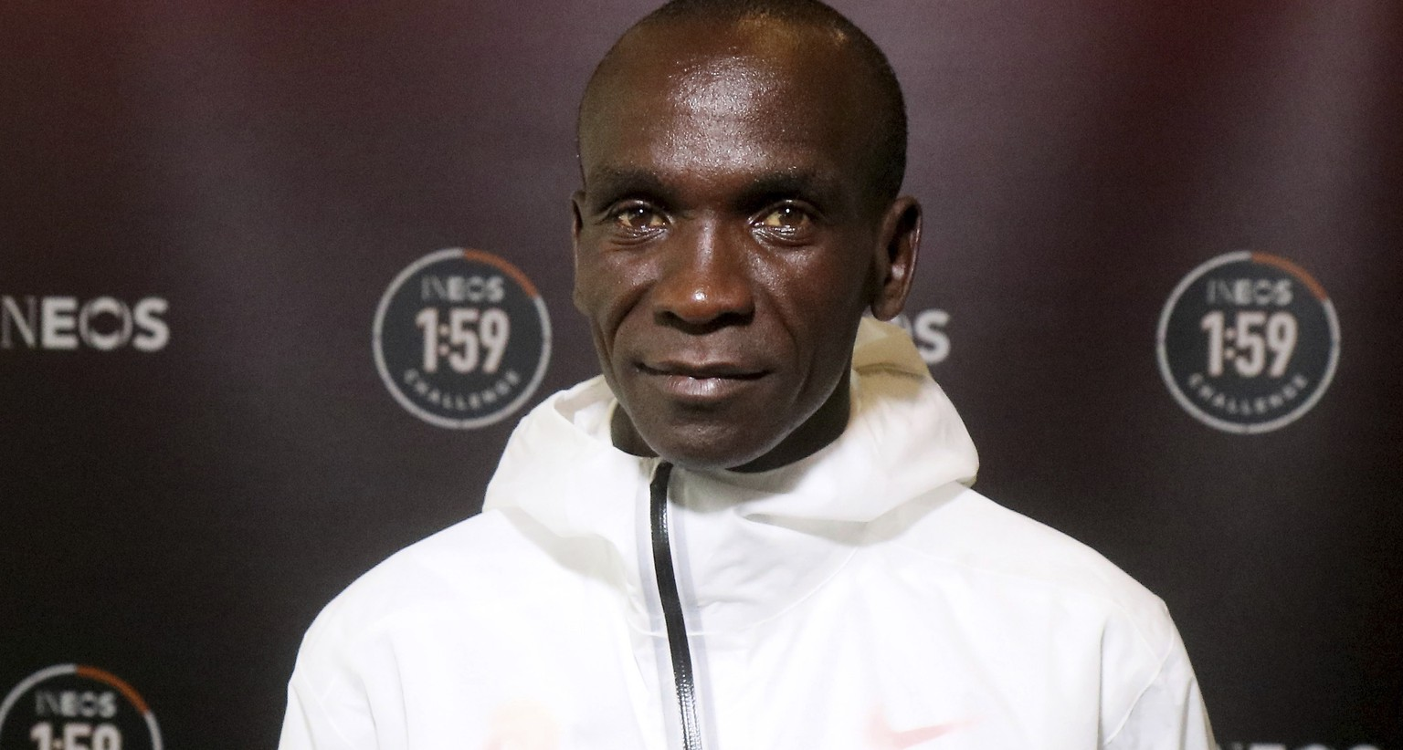 Marathon runner Eliud Kipchoge from Kenya poses for photographers prior to a press conference in Vienna, Austria, Thursday, Oct. 10, 2019. Kipchoge's attempt to run a sub two-hour marathon has been set for Saturday, Oct. 12 in Prater park, a landmark part of the Vienna City Marathon. (AP Photo/Ronald Zak)
