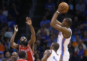 Oklahoma City Thunder forward Kevin Durant (35) shoots over Houston Rockets guard James Harden (13) during the second quarter of an NBA basketball game in Oklahoma City, Tuesday, March 11, 2014. Oklahoma City won 106-98. (AP Photo/Sue Ogrocki)