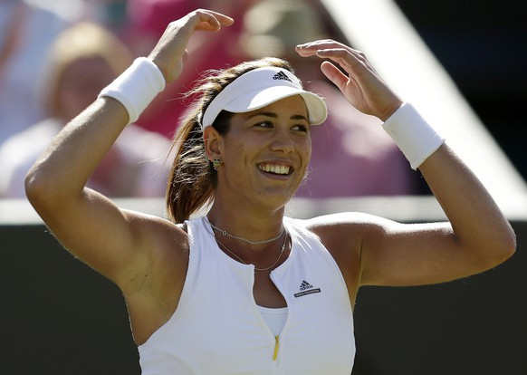 Garbine Muguruza of Spain celebrates after winning her match against Caroline Wozniacki of Denmark at the Wimbledon Tennis Championships in London, July 6, 2015.                REUTERS/Henry Browne