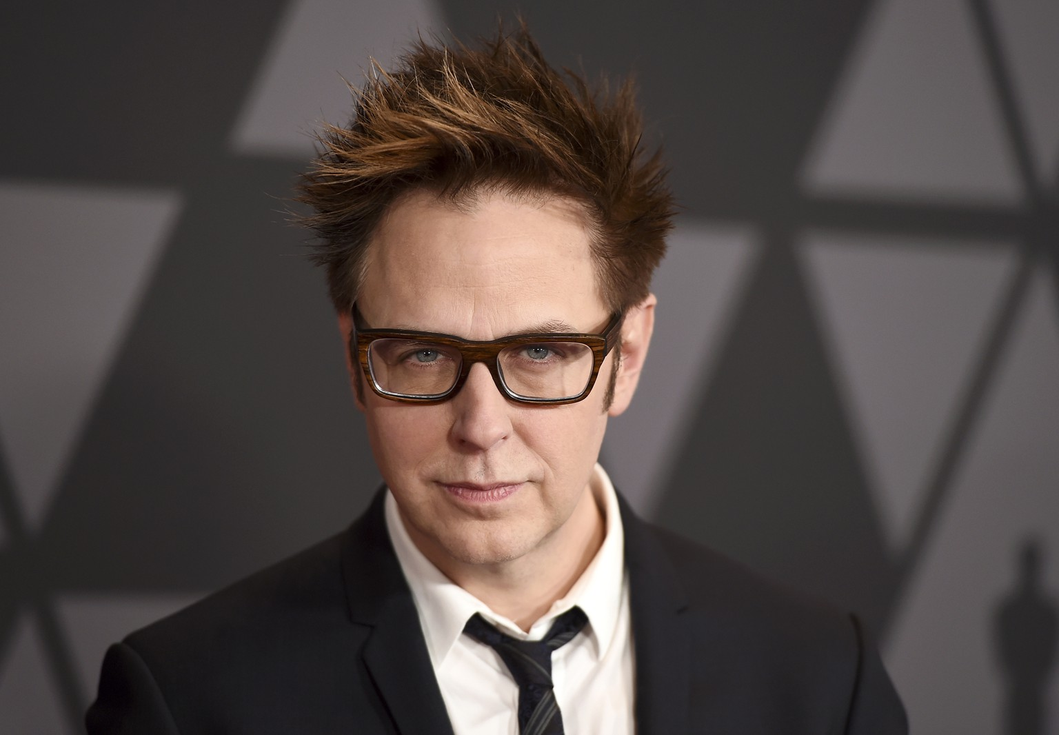 "FILE - In this Nov. 11, 2017 file photo, filmmaker James Gunn arrives at the 9th annual Governors Awards in Los Angeles. Gunn has been fired as director of ""Guardians of the Galaxy 3"" because of old tweets that recently emerged where he joked about subjects like pedophilia and rape. Walt Disney Studios Chairman Alan Horn said in a statement Friday, July 20, 2018, that the tweets are indefensible, and the studio has severed ties with Gunn. (Photo by Jordan Strauss/Invision/AP, File)"