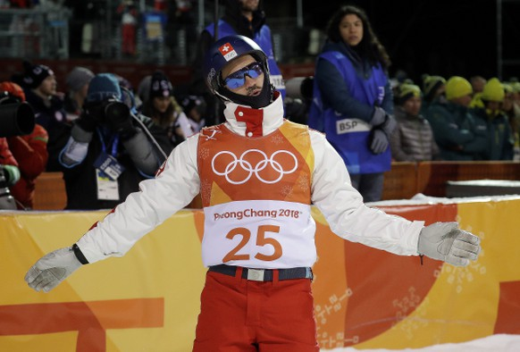 Dimitri Isler, of Switzerland, reacts to his score during the men's aerial final at Phoenix Snow Park at the 2018 Winter Olympics in Pyeongchang, South Korea, Sunday, Feb. 18, 2018. (AP Photo/Kin Cheung)