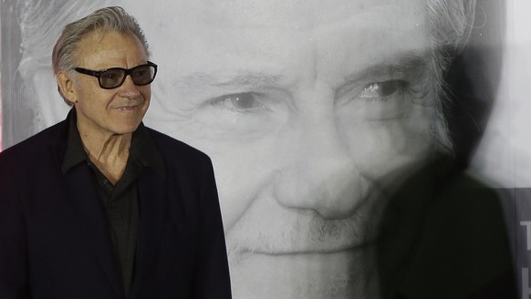 U.S. actor Harvey Keitel arrives to participate in his hand printing ceremony during the Busan International Film Festival at Outdoor Stage-BIFF Village in Busan, South Korea, Saturday, Oct. 3, 2015. (AP Photo/Ahn Young-joon)