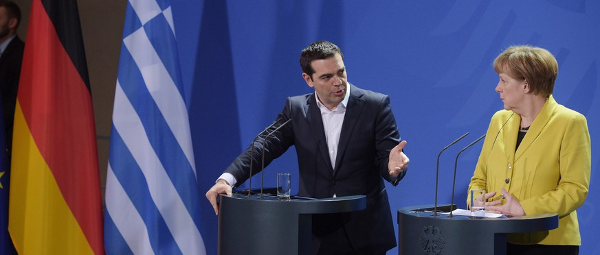 epa04676360 German Chancellor Angela Merkel (R) and Greek Prime Minister Alexis Tsipras (L) hold a joint press conference on their previous talk in the Federal Chancellery in Berlin, Germany, 23 March 2015. Tsipras is expected to present a list of reforms, hoping to unlock bailout funds to prevent Greece from running out of cash next month, Greek government sources said.  EPA/RAINER JENSEN