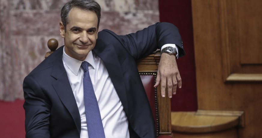 Greece's Prime Minister Kyriakos Mitsotakis smiles during a parliamentary session to present his government's policies in Athens, Saturday, July 20, 2019.(AP Photo/Petros Giannakouris) Kyriakos Mitsotakis