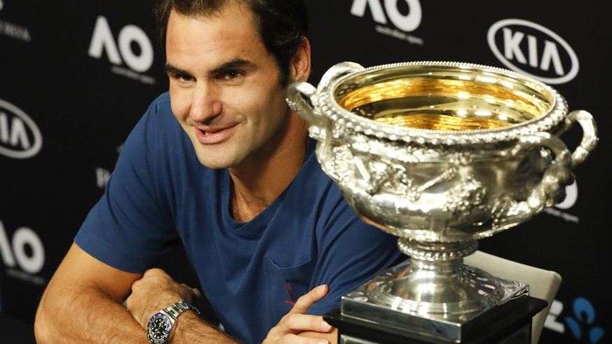 Switzerland's Roger Federer answers questions at a press conference after defeating Spain's Rafael Nadal in the men's singles final at the Australian Open tennis championships in Melbourne, Australia, Monday, Jan. 30, 2017. (AP Photo/Kin Cheung)