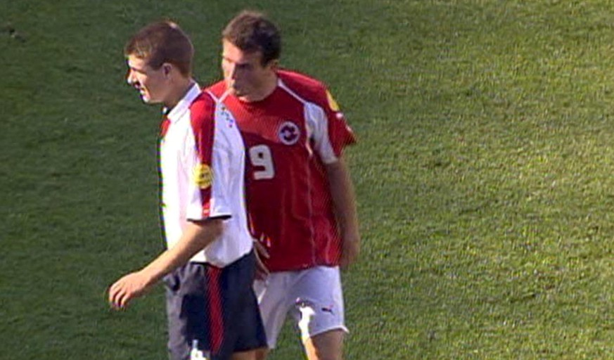 This video grab image provided by Swiss Television SFDRS on Sunday June 20, 2004, shows Swiss player Alex Frei spitting towards English player Steven Gerrard, during the match Switzerland against England, Thursday, June 17, 2004 in Coimbra, Portugal.After the UEFA discharged Frei on Sunday from the accusation of spitting at English player Steven Gerrard, an UEFA official announced further investigations on Sunday evening after seeing the new images of the incident. (KEYSTONE/SFDRS) === , , TV OUT, BEST QUALITY AVAILABLE ===