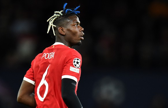 epa09496536 Paul Pogba of Manchester United during the UEFA Champions League group F soccer match between Manchester United and Villarreal CF in Manchester, Britain, 29 September 2021.  EPA/Peter Powell