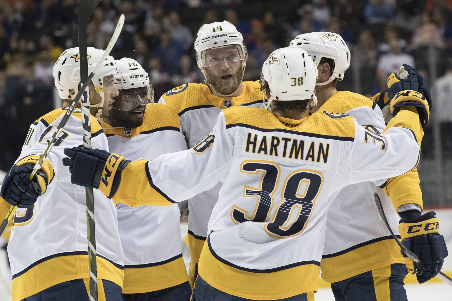 Nashville Predators defenseman Mattias Ekholm, center, celebrates scoring a goal with his team mates during the first period of an NHL hockey game against the New York Islanders, Saturday, Oct. 6, 2018, in New York. (AP Photo/Mary Altaffer)