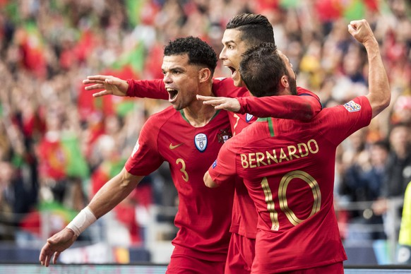Portugal's defender Pepe, Portugal's forward Cristiano Ronaldo and Portugal's midfielder Bernardo Silva, from left, celebrate during the UEFA Nations League semi-final soccer match between Portugal and Switzerland at the Dragao stadium in Porto, Portugal, on Wednesday, June 5, 2019. (KEYSTONE/Jean-Christophe Bott)