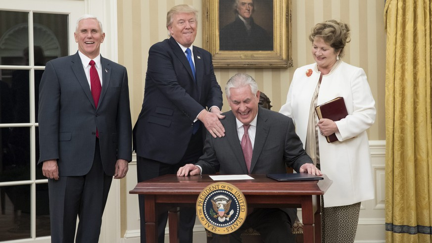 epa05765730 US President Donald J. Trump (2-L) reacts after Rex Tillerson (2-R) signed an appointment affidavit after being sworn-in as US Secretary of State by US Vice President Mike Pence (L), as Tillerson's wife Renda St. Clair (R) looks on, in the Oval Office of the White House in Washington, DC, USA, 01 February 2017. Tillerson was confirmed by the Senate, on 01 February, in a 56-to-43 vote to become the nation's 69th Secretary of State.  EPA/MICHAEL REYNOLDS / POOL