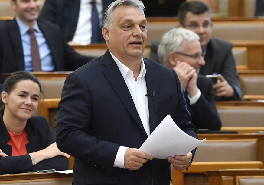 Hungarian Prime Minister Viktor Orban replies to an independent MP during a question and answer session of the Parliament in Budapest, Hungary, Monday, March 30, 2020. MPs with 137 yes votes and 53 no votes have approved legislation that extends a state of emergency and gives the government extraordinary powers to enact measures to contain the spread of the novel coronavirus. The new coronavirus causes mild or moderate symptoms for most people, but for some, especially older adults and people with existing health problems, it can cause more severe illness or death. (Zoltan Mathe/MTI via AP)