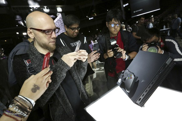 IMAGE DISTRIBUTED FOR MICROSOFT - Fans interact with the Xbox One X at the Xbox Media Showcase at E3 2017 in Los Angeles on Monday, June 12, 2017. (Photo by Casey Rodgers/Invision for Microsoft/AP Images)