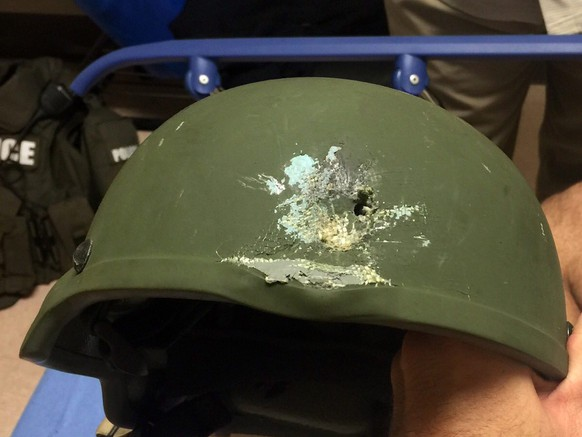 epa05359475 A handout photograph made available by the Orlando Police showing the Kevlar helmet that saved the life of a OPD officer who was hit in hail of gunfire in which suspect was killed, following a shooting at Pulse nightclub in Orlando, Florida, USA, 12 June 2016. At least 50 people were killed and many others injured in a suspected terrorist attack at an LGBT club in the early hours of 12 June. The shooter was killed in the police operation that followed, media reported.  EPA/ORLANDO POLICE / HANDOUT  HANDOUT EDITORIAL USE ONLY/NO SALES