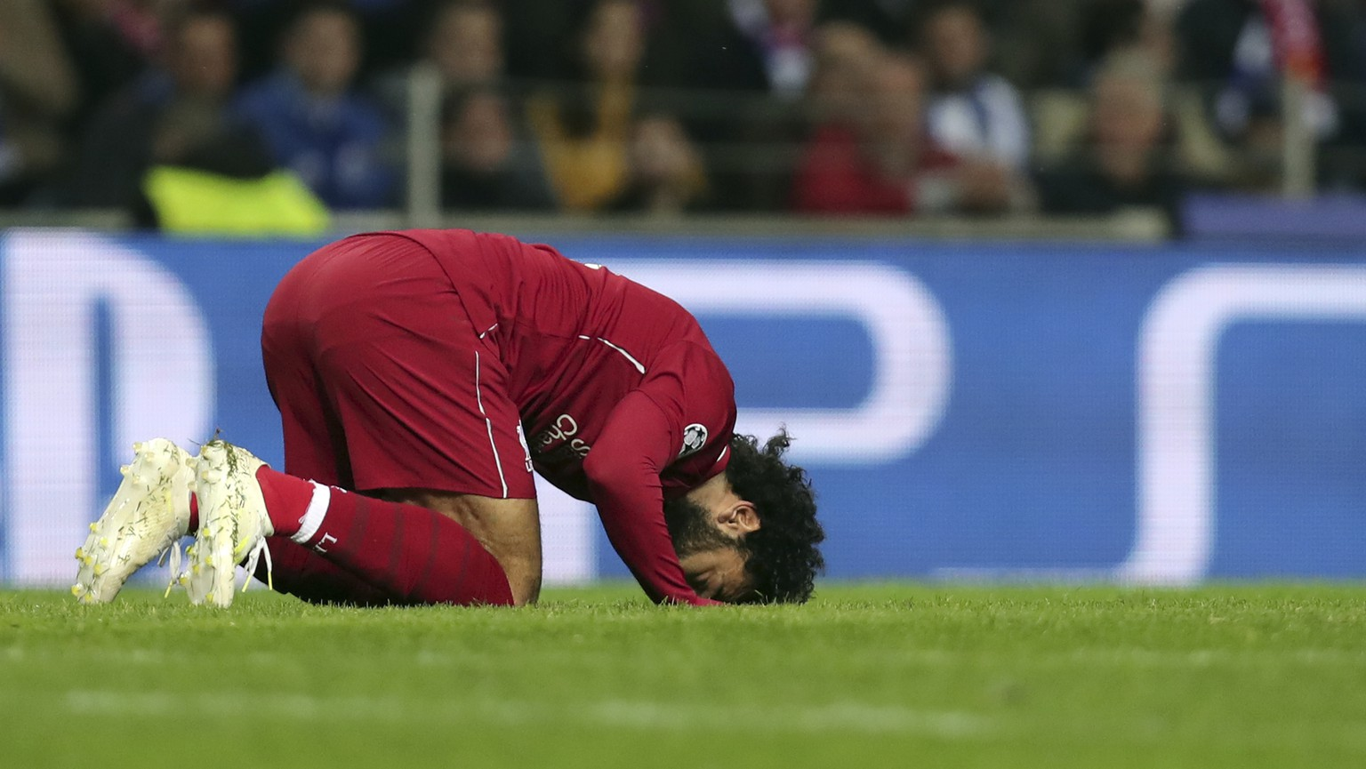 Liverpool's Mohamed Salah celebrates after scoring his side's second goal during the Champions League quarterfinals, 2nd leg, soccer match between FC Porto and Liverpool at the Dragao stadium in Porto, Portugal, Wednesday, April 17, 2019. (AP Photo/Luis Vieira)