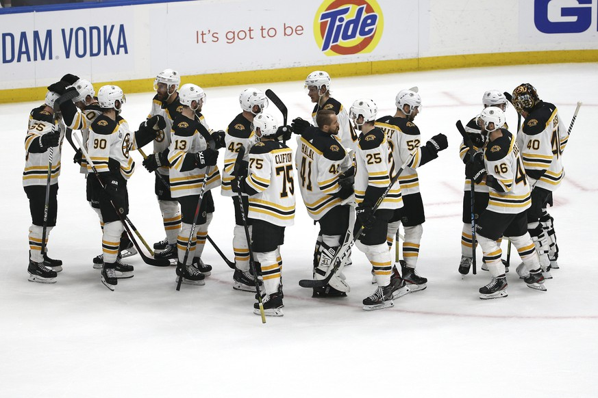 Boston Bruins players celebrate as they leave the ice after beating the St. Louis Blues in Game 3 of the NHL hockey Stanley Cup Final Saturday, June 1, 2019, in St. Louis. The Bruins won 7-2 and lead the series 2-1. (AP Photo/Scott Kane)