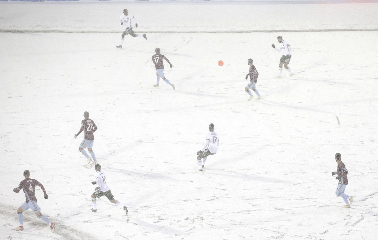 The Colorado Rapids play the Portland Timbers on a snow-covered pitch during the second half of an MLS soccer game Saturday, March. 2, 2019 in Commerce City, Colo. (AP Photo/Joe Mahoney)
