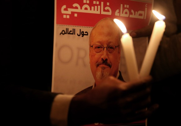 epa07119344 Protestors hold candles and pictures of Jamal Khashoggi during the demonstration in front of Saudi Arabian consulate in Istanbul, Turkey, 25 October 2018. Turkish President Erdogan addressed the parliament on the case of Saudi journalist Jamaal Khashoggi on 23 October 2018, media reported that he said that Turkish investigators have strong evidence that Khashoggi's death was planned, and demanded that the whereabouts of the dead journalist's body be revealed and the suspects face trial in Turkey. Saudi Arabian official media on 19 October reported that journalists Jamal Khashoggi died as a result of a physical altercation inside the kingdom's consulate in Istanbul, where he was last seen entering on 02 October for routine paperwork. On 24 October, Mohammed bin Salman spoke of the killing of Khashoggi for the first time, describing it as 'a heinous crime that cannot be justified', and that Saudi Arabia and Turkey will work together to punish all culprits.  EPA/ERDEM SAHIN