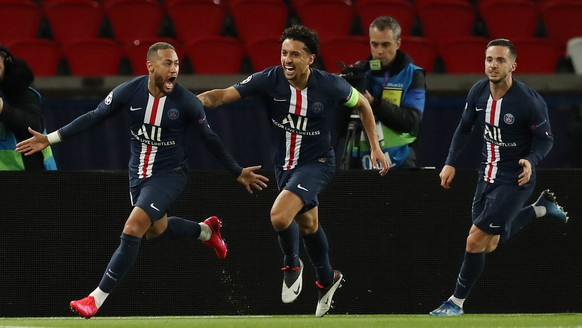 epa08287336 A handout photo made available by the UEFA shows (L-R) Neymar of Paris Saint-Germain celebrating with team mates Marquinhos and Pablo Sarabia after scoring the 1-0 goal during the UEFA Champions League round of 16 second leg match between Paris Saint-Germain and Borussia Dortmund at Parc des Princes stadium in Paris, Frane, 11 March 2020. The match takes place behind closed doors as a precaution against the spread of COVID-19 (Coronavirus).  EPA/UEFA via Getty Images / HANDOUT  HANDOUT EDITORIAL USE ONLY/NO SALES/NO ARCHIVES