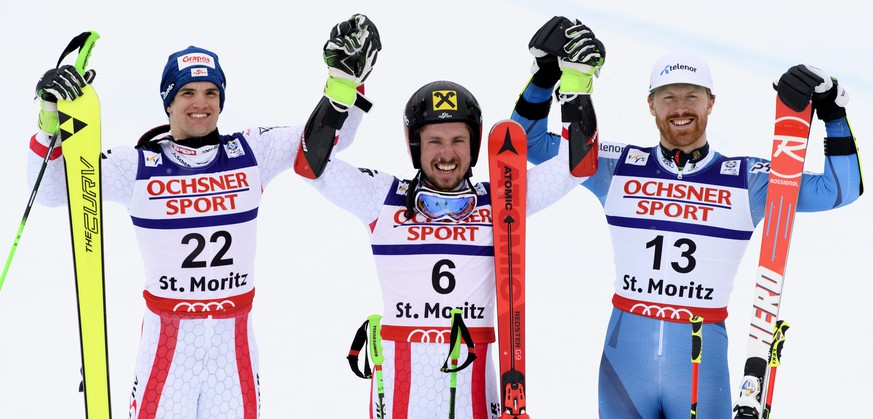 From left, silver medalist Austria's Roland Leitinger, gold medalist Austria's Marcel Hirscher and bronze medalist Norway's Leif Kristian Haugen celebrate in the finish area after the men's Giant Slalom at the 2017 Alpine Skiing World Championships in St. Moritz, Switzerland, Friday, Febr. 17, 2017. (Peter Schneider/Keystone via AP)