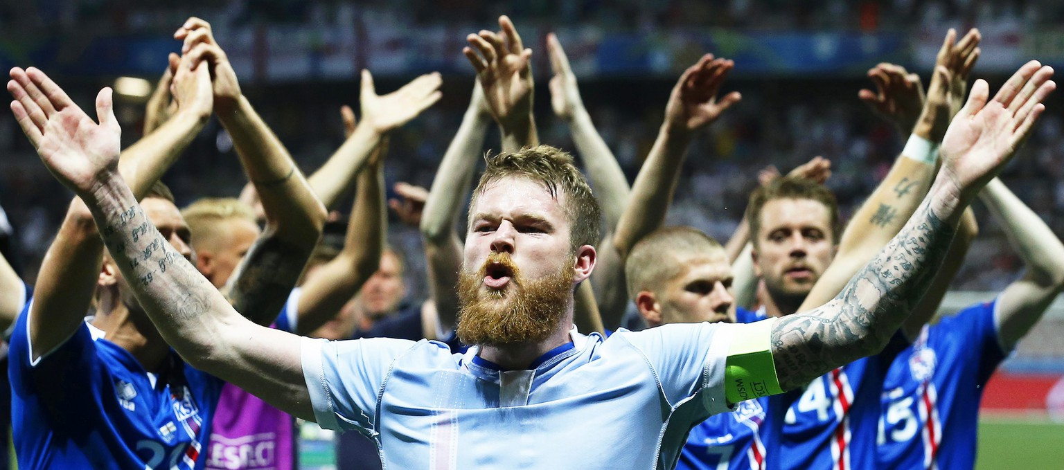 epa05395449 Aron Gunnarsson (front) of Iceland and his teammates celebrate after the UEFA EURO 2016 round of 16 match between England and Iceland at Stade de Nice in Nice, France, 27 June 2016. Iceland won 2-1.