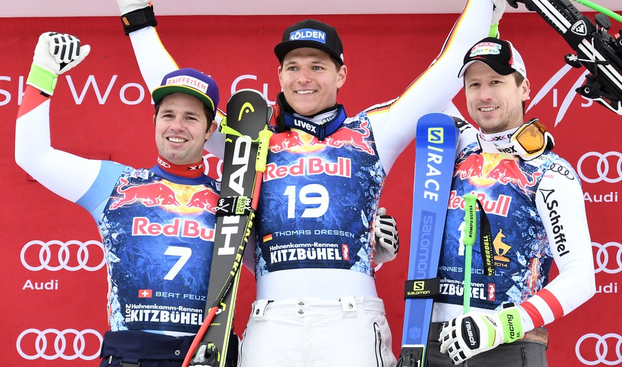 epa06457070 Second placed Beat Feuz of Switzerland (L), winner Thomas Dressen of Germany (C) and third placed Hannes Reichelt of Austria (R) react on the podium after the Men's Downhill race of the FIS Alpine Skiing World Cup event in Kitzbuehel, Austria, 20 January 2018.  EPA/CHRISTIAN BRUNA