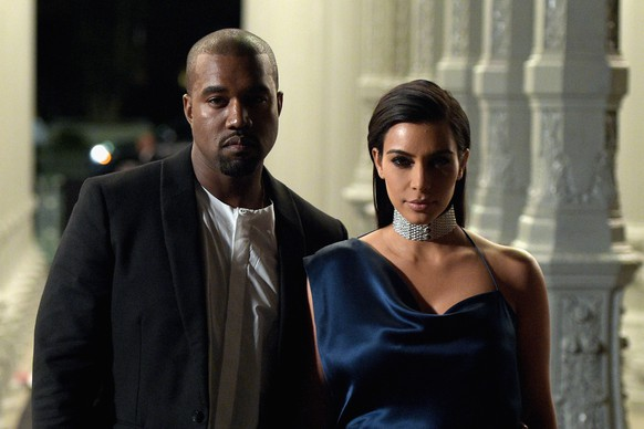 LOS ANGELES, CA - NOVEMBER 01:  Rapper Kanye West (L) and TV personality Kim Kardashian attend the 2014 LACMA Art + Film Gala honoring Barbara Kruger and Quentin Tarantino presented by Gucci at LACMA on November 1, 2014 in Los Angeles, California.  (Photo by Jason Kempin/Getty Images for LACMA)