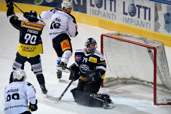 Zug's player Raphael Diaz center make the 1 - 1 goal, during the preliminary round game of National League Swiss Championship 2018/19 between HC Ambri Piotta and EV Zug, at the ice stadium Valascia in Ambri, Switzerland, Friday,  February 01, 2019. (KEYSTONE/Ti-Press/Samuel Golay)