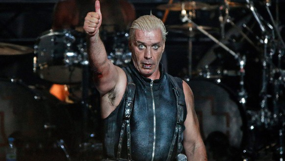 epa03810630 Lead singer Till Lindemann of German rock band Rammstein gives a thumb up at the Wacken Open Air music festival in Wacken, Germany, 01 August 2013. Around 75,000 visitors are expected at the 24th Wacken Open Air heavy metal festival that runs from 01 to 03 August.  EPA/Axel Heimken