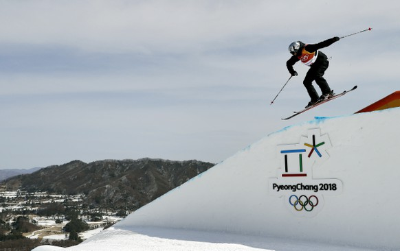 Elias Ambuehl, of Switzerland, jumps during the men's slopestyle qualifying at Phoenix Snow Park at the 2018 Winter Olympics in Pyeongchang, South Korea, Sunday, Feb. 18, 2018. (AP Photo/Kin Cheung)