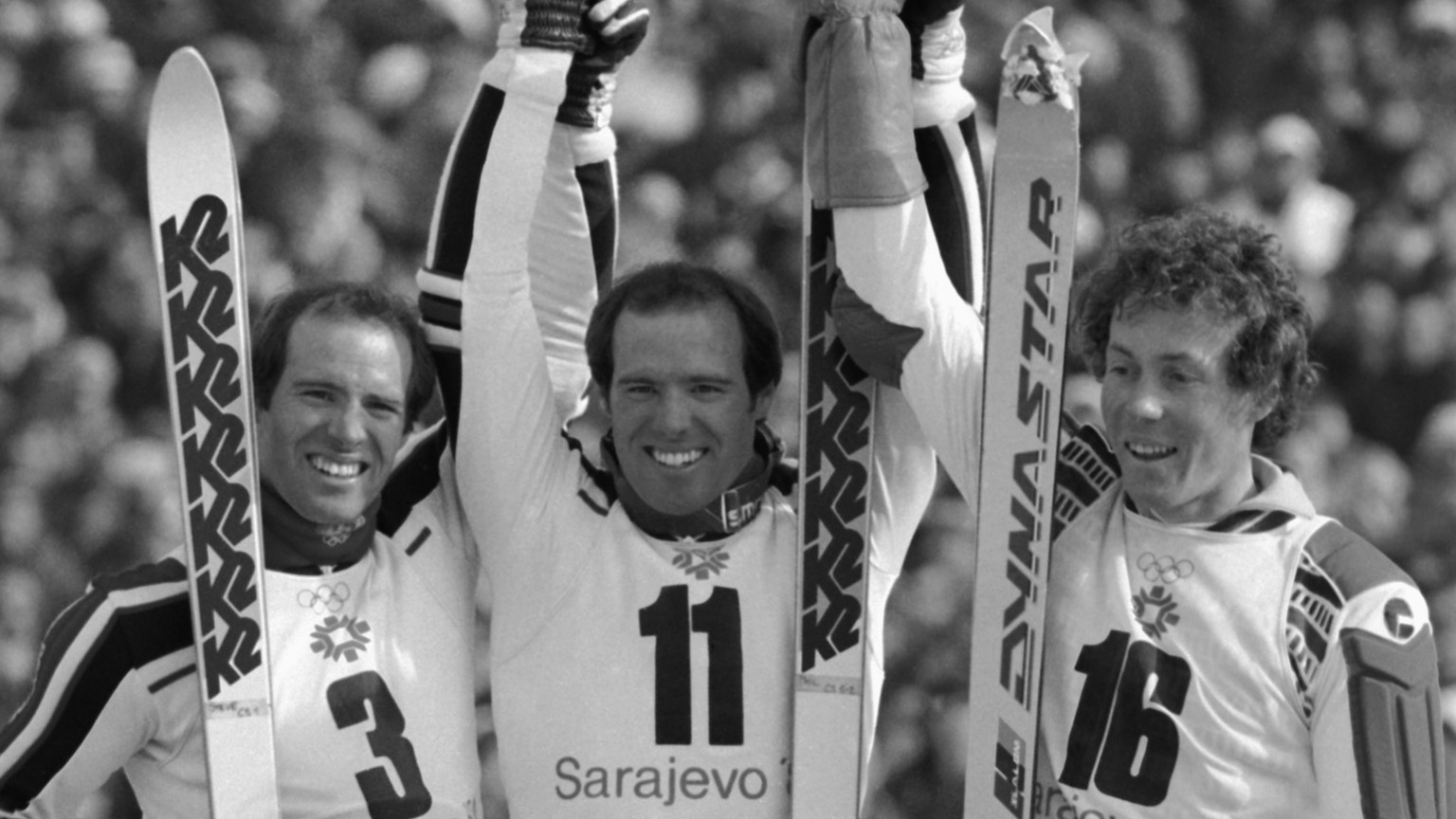 Phil Mahre (11) stands with his brother Steve (3) and Didier Bouvet (16) of France after the XIV Winter Olympics slalom on Mt. Bjelasnica in Sarajevo, Feb. 19, 1984. Americans Phil and Steve took top honors with Phil winning and gold and Steve, silver. Bouvet took the bronze medal. (AP Photo/Jack Smith)