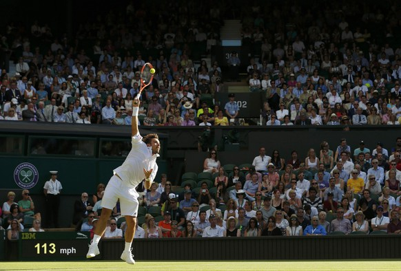 Stan Wawrinka of Switzerland serves during his match against Joao Sousa of Portugal at the Wimbledon Tennis Championships in London, June 29, 2015.   REUTERS/Suzanne Plunkett