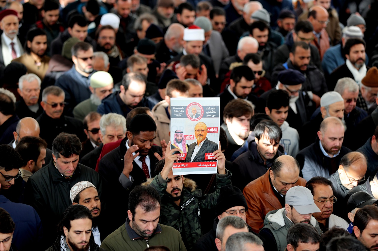 epa07169793 People hold photo of slain Saudi journalist Jamal Khashoggi as they perform a prayer at Fatih Mosque in Istanbul, Turkey, 16 November 2018. According to reports, Saudi Arabia's Attorney General Saud al-Mujeb on 15 November told a press conference that an order to bring back Saudi journalist Jamal Khashoggi to Saudi Arabia, even by force, was issued on 29 September by the former Deputy President of the General Intelligence Presidency. Al-Mujeb announced he had requested the death penalty for five people who have allegedly confessed to their involvement in the killing of Khashoggi at the kingdom's consulate building in Istanbul on 02 October and confirmed that 11 people had been accused of participating in the assassination of Khashoggi.  EPA/TOLGA BOZOGLU