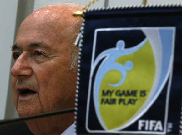 FIFA President Joseph Blatter speaks during a news conference after an event celebrating the 100th anniversary of Hong Kong's Football Association in Hong Kong April 24, 2014. REUTERS/Bobby Yip (CHINA - Tags: SPORT SOCCER HEADSHOT TPX IMAGES OF THE DAY)