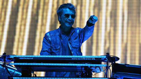 epa06090387 French musician Jean Michel Jarre performs  during the Les Vieilles Charrues Festival in Carhaix, France, 15 July 2017. The music festival runs from 13 to 16 July.  EPA/HUGO MARIE