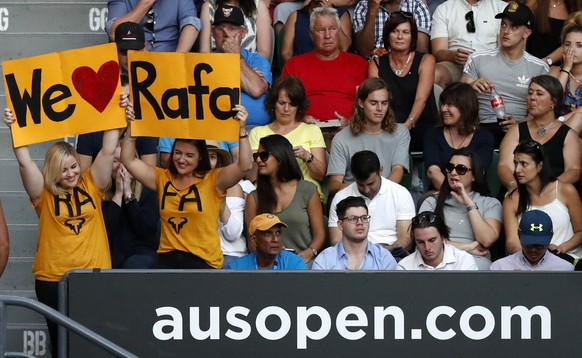 Fans hold up banners in suppor of Spain's Rafael Nadal during his semifinal against Bulgaria's Grigor Dimitrov at the Australian Open tennis championships in Melbourne, Australia, Friday, Jan. 27, 2017. (AP Photo/Kin Cheung)
